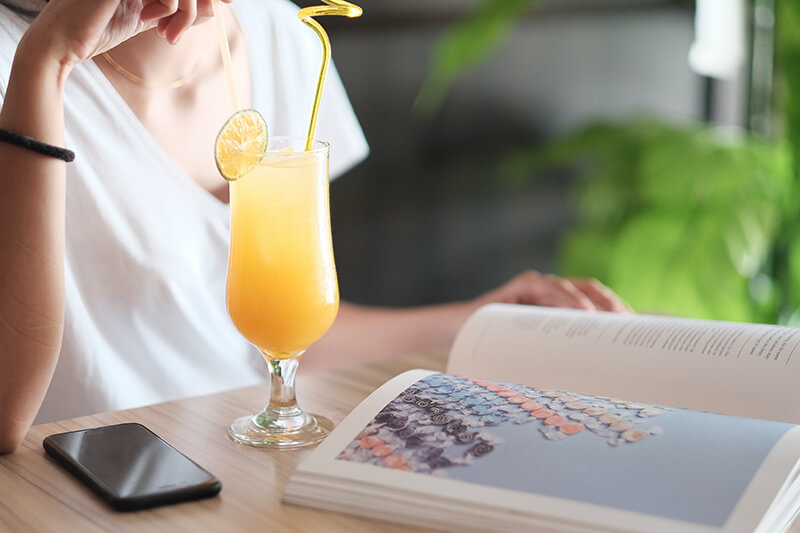 photo of a mimosa and a woman's torso